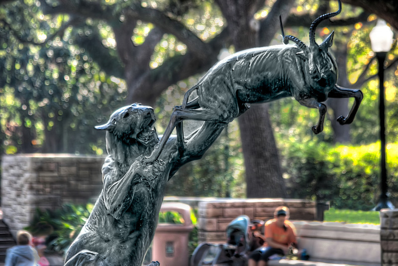 The Houston Zoo has a tree lined fountain where you can rest your tired feet and watch the two-legged animals with baby strollers walk by. Their statue in the water feature reminds you of the reality of animal kingdom and the circle does have an end. Photo by Tim Stanley Photography.