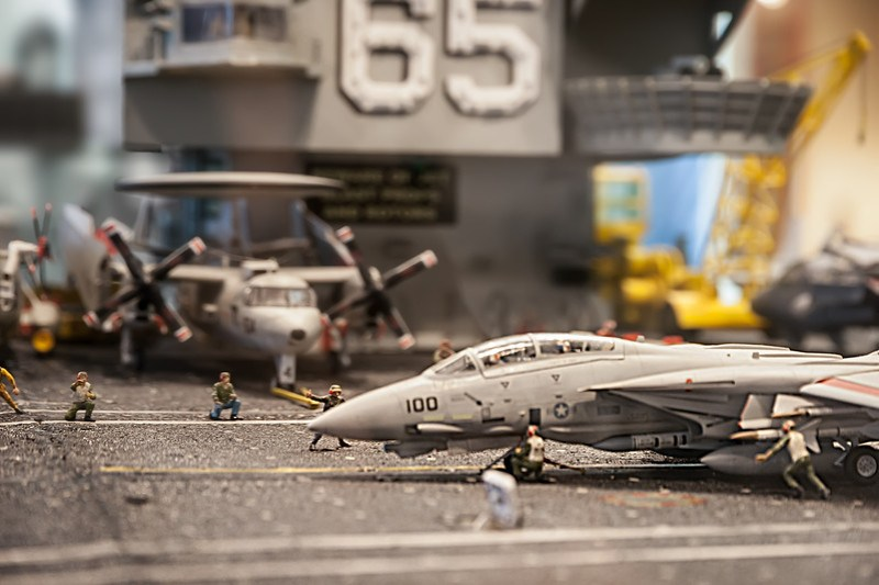 This is a close-up of an F-14 Tomcat preparing for take-off on the USS Enterprise. Shooting these models is almost as hard as making them. They are enclosed in thick plastic display cases which can show tiny scratches, finger prints and LOTS of glare. It's worth the effort to try shooting a few of these so when you look back later, it will bring a smile to that little boy inside. Photo by Tim Stanley Photography.