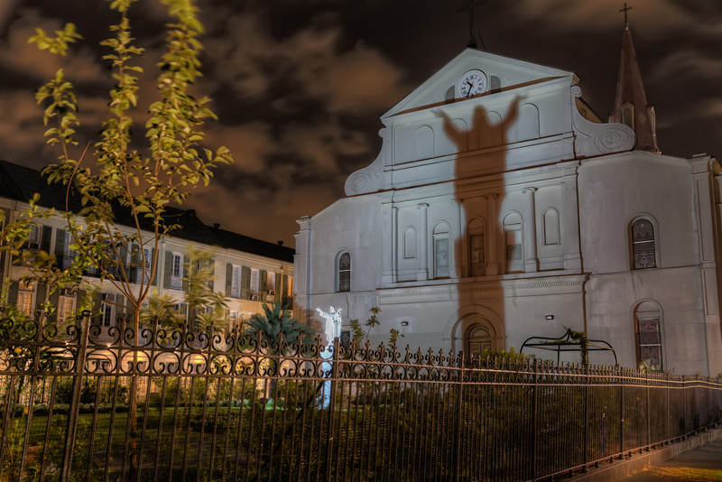 If you walk around behind the St. Louis Cathedral, you can see a statue of Jesus Christ, standing with arms raised as if to invite all to come. Photo by Tim Stanley Photography.