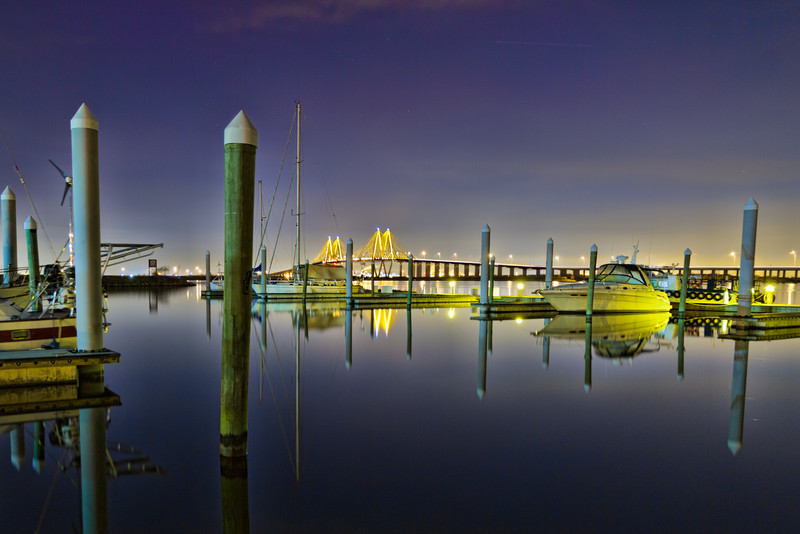 It had been a beautiful, sunny December day, and my friend and I had already photographed several locations. But the weather quickly grew cold after the sun went down. We went across town to Bayland Marina for a great view of the Fred Hartman Bridge at night. Photo by Tim Stanley Photography.