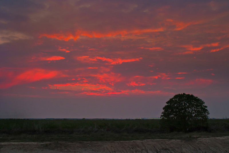 Smoke from Texas wildfires contributed to the clouds in this sunset. PHoto by Tim Stanley Photography.