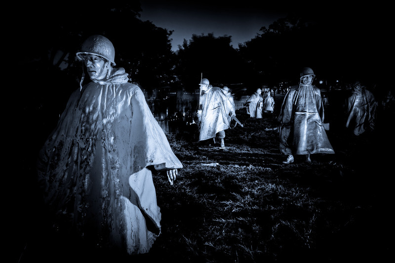 The Korean War Memorial in Washington D.C. was eerie to experience in the dark and rain. The fact the statues had rain parkas on only added to the realism and drew you in to their moment. Photo by Tim Stanley Photography.