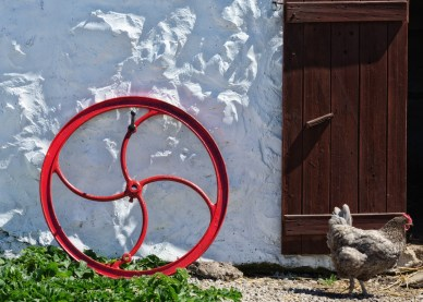 A Red Wheel and Crooked Door
