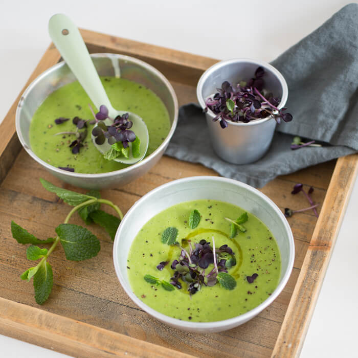 green pea soup with mint and microgreens