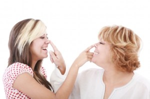 two people touching noses