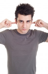 Guy with fingers in ears