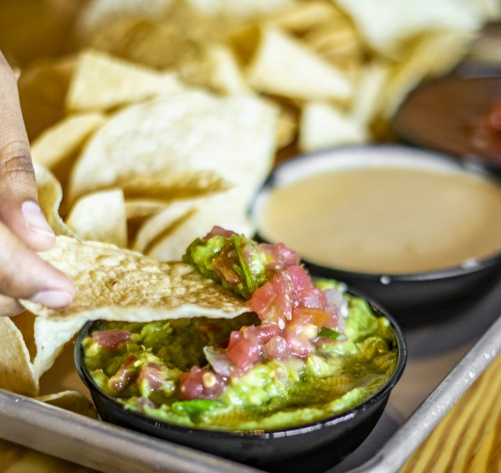 Guacamole Salsa and queso Nachos at Tin and Taco