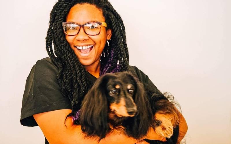 Tina Holding a dog