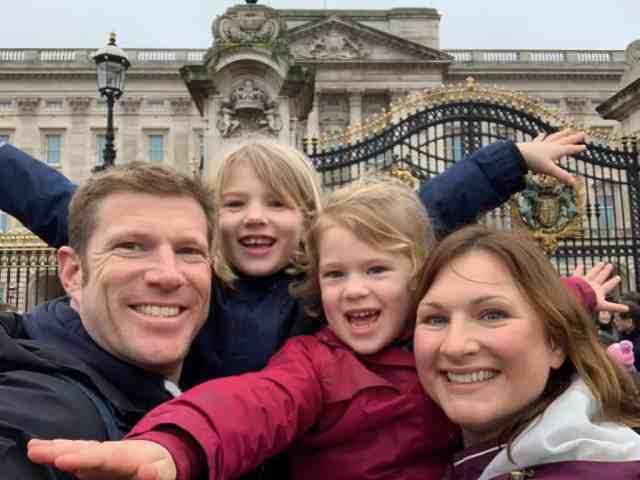 Family selfie outside Buckingham Palace in London