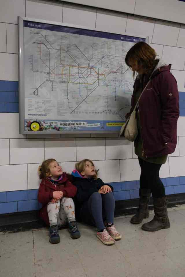 Kids sat on floor in Green Park tube station
