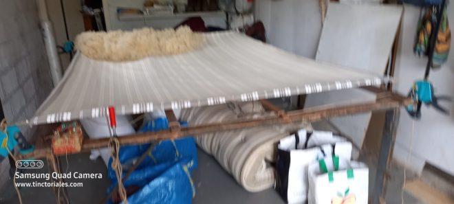 Disposition de la première couche du matelas de laine