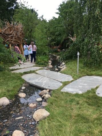 A stream meanders through the garden