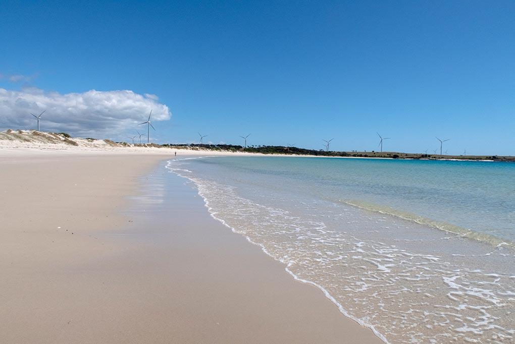 Cape Portland beach with wind turbines in the background, Tasmania