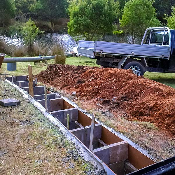 Section being boxed prior to laying the cement for the micro hydro tail race.