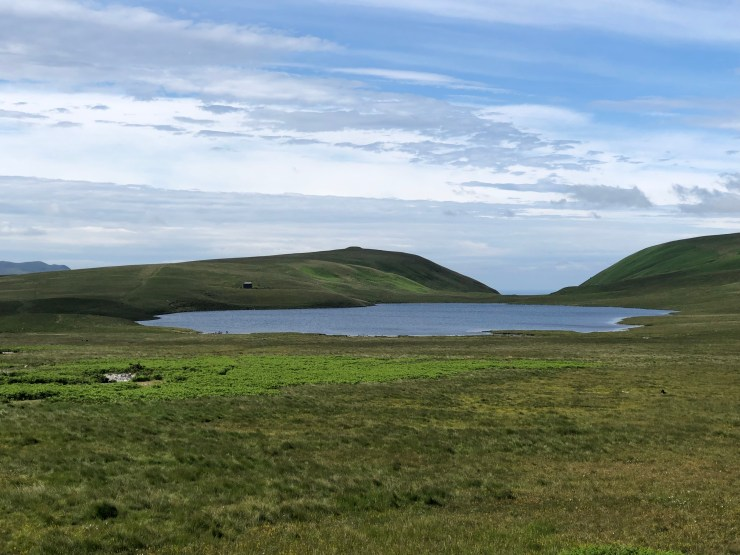 view across Burnmoor Tarn to the Lodge