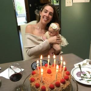 Mommy Holding Eileah Before Bowing Out Her Birthday Cake Candles