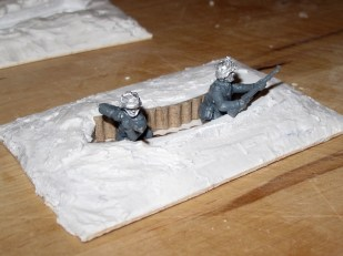 The tricky bit is getting the poses on the miniatures to look right once they're in a hole.
