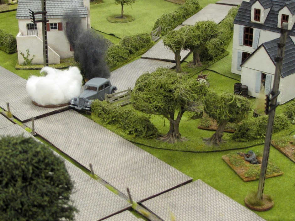 The General's car right in the middle of the battle. The white smoke is from friendly smoke grenades, the black is from where a British flamethrower incinerated a hedge.