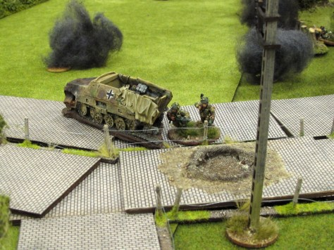 The brave PIAT team finally decides to find some cover as mortar bombs rain down nearby.