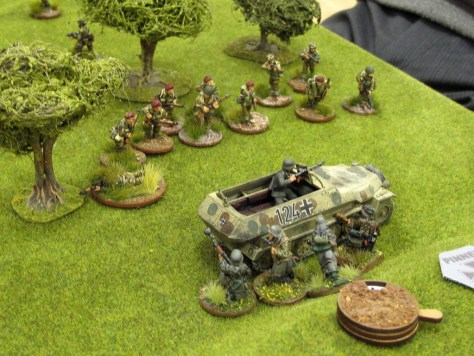 Totally outgunned by the Paras, the remnants of the German squad in the Hanomag takes shelter behind their vehicle.