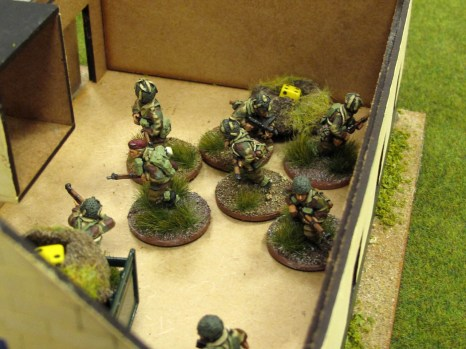 A little worse for wear, the Paras manage to force their way into the garage, killing the Germans inside