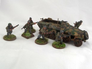 German Panzergrenadiers pile out of their Hanomag and go looking for trouble