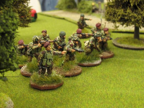 The last British section deploys into the woods, closing off the objective...