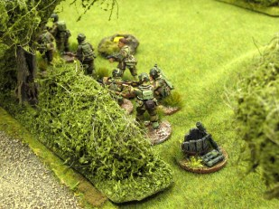 The British deploy into the hedgerow along the sunken lane