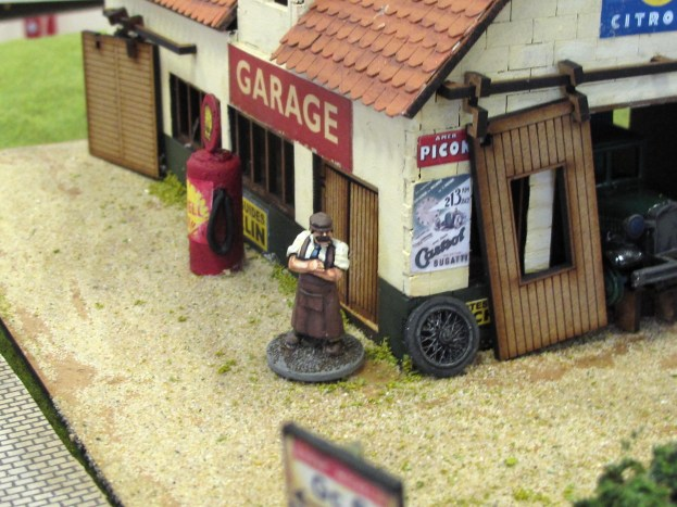 An opportunistic French garage owner keeps his shop open, hoping to do some business filling up the tanks of the approaching 21st Panzer Div