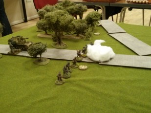 The Germans move a section into the open and immediately start taking fire
