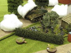"""While the 2"""" mortar tries to blind the howitzer, more panzergrenadiers work their way forward"""
