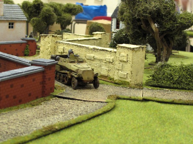 The halftrack took a battering from a Bren gun and reversed back around the corner