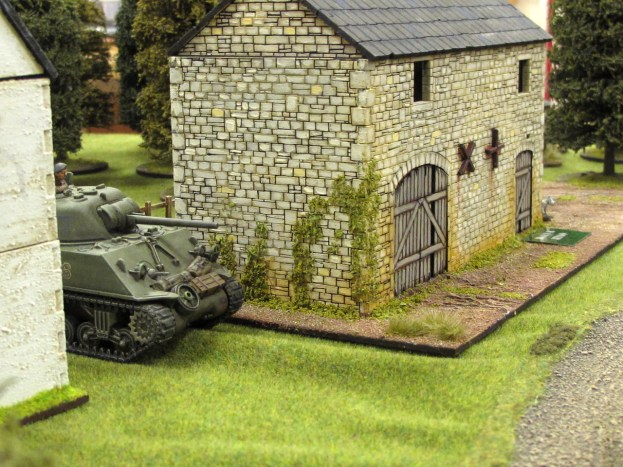 A Sherman model standing in for the Churchill AVRE enters the table