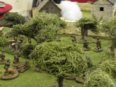 Troops advance towards the walls of the farm compound