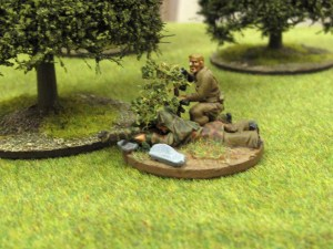 The British sniper took up position on the ede of the woods