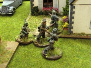 German guards scramble to the farmhouse