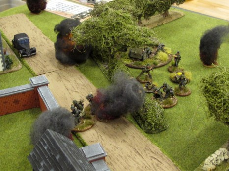 The mortar barrage corrects onto the Germans, catching several in the open