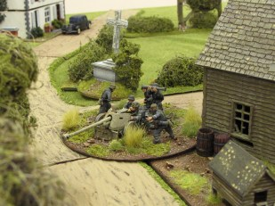 Deploying at the crossroads, the Pak 40 fights off the Sherman...