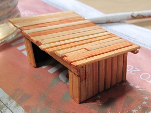 The coffee-stirrer hut, washed with brown ink before being done in black