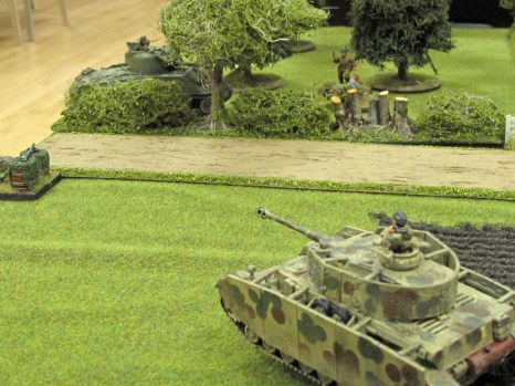 End game. The panzer bears down on the British officer and his PIAT team, near the damaged and abandoned Sherman.