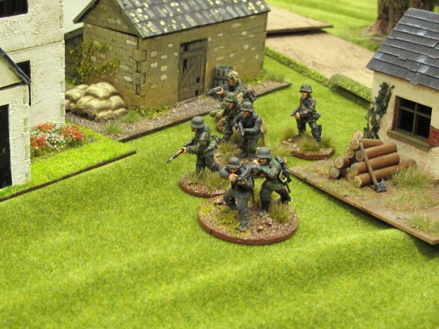 German troops move up into the farmyard on one flank