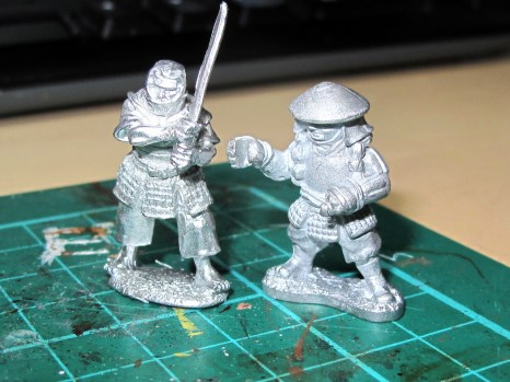 Dixon (right) and a more realistically proportioned Perry sculpt (left)