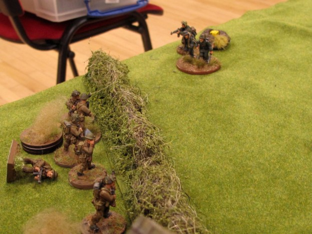 The German squad in the open gets shot to bits