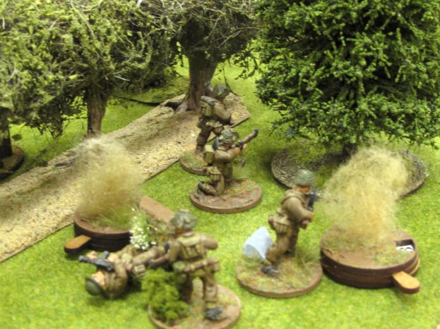 Under heavy pressure, the other British section falls back