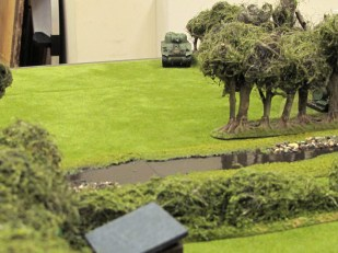 Desperate measures! A Sherman turns up to try and stop the rout...