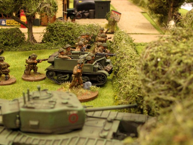 The Brits build up a base of fire in the hedge...