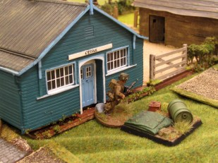 A British section deploys into the school and their Bren fires down the hedgeline at...