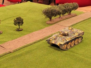 Meanwhile the Panther advances towards the orchard