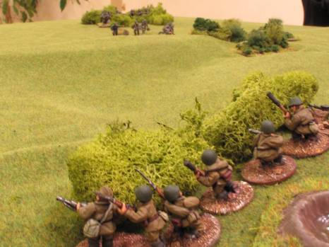 The left-hand Soviet squad, firing from the bushes