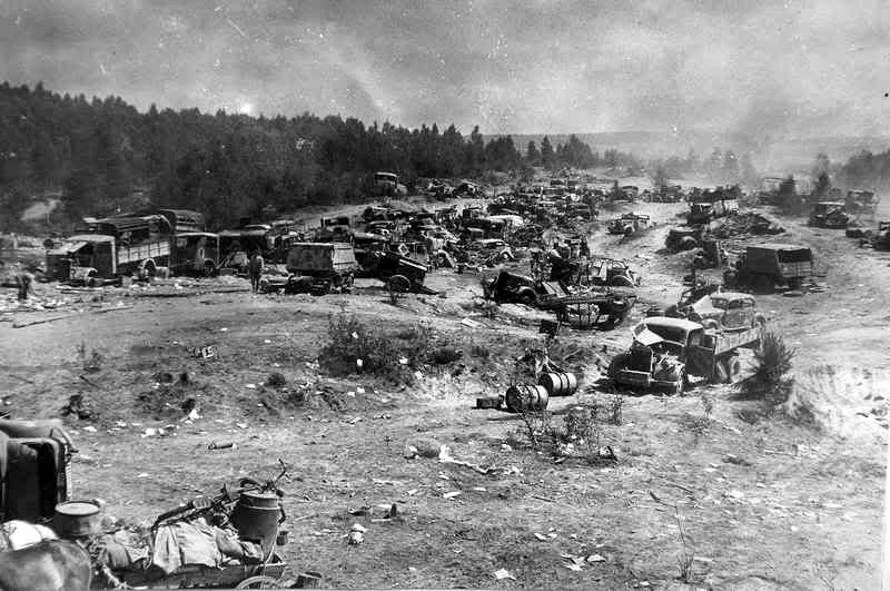 Dozens of destroyed German vehicles lie abandoned
